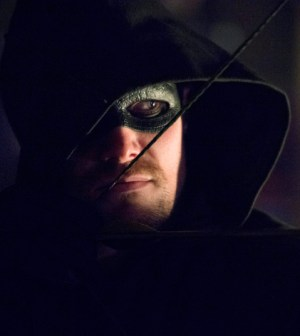 Our new favorite image of Stephen Amell as Arrow. Photo: Diyah Pera/The CW
