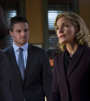 Pictured (L-R): Adrian Holmes as Lt. Pike, Stephen Amell as Oliver Queen, and Susanna Thompson as Moira Queen -- Photo: Diyah Pera/The CW