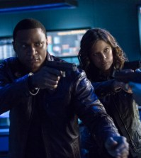 Pictured (L-R): David Ramsey as John Diggle and Audrey Marie Anderson as Lyla -- Photo: Cate Cameron/The CW
