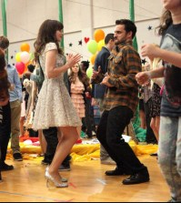 Jess (Zooey Deschanel, L) and Nick (Jake Johnson, R) join in the fun at the school dance. Co. Cr: Adam Taylor/FOX