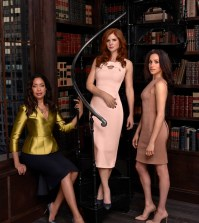 Pictured: (l-r) Gina Torres as Jessica Pearson, Sarah Rafferty as Donna Paulsen, Meghan Markle as Rachel Zane -- (Photo by: Nigel Parry/USA Network)