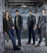 Pictured: (l-r) Emily Rose as Audrey Parker, Lucas Bryant as Nathan Wuornos, Adam Copeland as Dwight Hendrickson, Eric Balfour as Duke Crocker -- (Photo by: Steven Wilkie/Syfy)