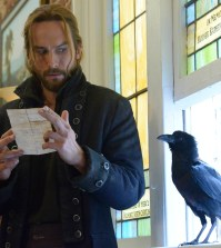 Crane (Tom Mison)  receives a message.  Co. CR: Brownie Harris/FOX