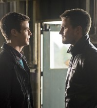 Pictured (L-R): Grant Gustin as Barry Allen and Stephen Amell as Oliver Queen -- Photo: Diyah Pera/The CW