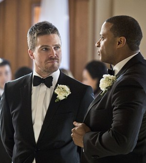 Pictured (L-R): Stephen Amell as Oliver Queen and David Ramsey as John Diggle -- Photo: Katie Yu/The CW