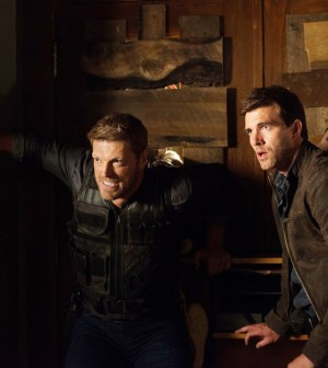 Pictured: (l-r) Adam Copeland as Dwight Hendrickson, Lucas Bryant as Nathan Wuornos -- (Photo by: Mike Tompkins/Syfy)