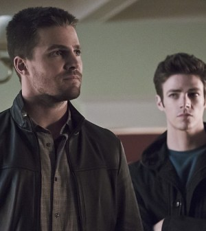Pictured (L-R): Stephen Amell as Oliver Queen and Grant Gust as Barry Allen  -- Photo: Katie Yu/ The CW