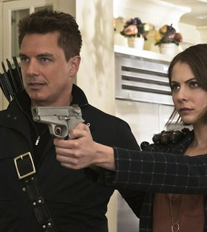 Pictured (L-R): John Barrowman as Malcolm Merlyn and Willa Holland as Thea Queen -- Photo: Katie Yu/The CW