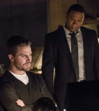 Pictured (L-R): Stephen Amell as Oliver Queen and David Ramsey as John Diggle -- Photo: Jack Rowand/The CW