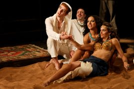 "Adam Standley as Alexas, Mike Dooly as ensemble, Allison Strickland as Iras and Amy Thone as Cleopatra in Seattle Shakespeare Company's 2012 production of ""Antony and Cleopatra."" Photo by John Ulman."