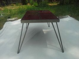 After: Martinez hand forged a base and hairpin legs to give it a retro feel