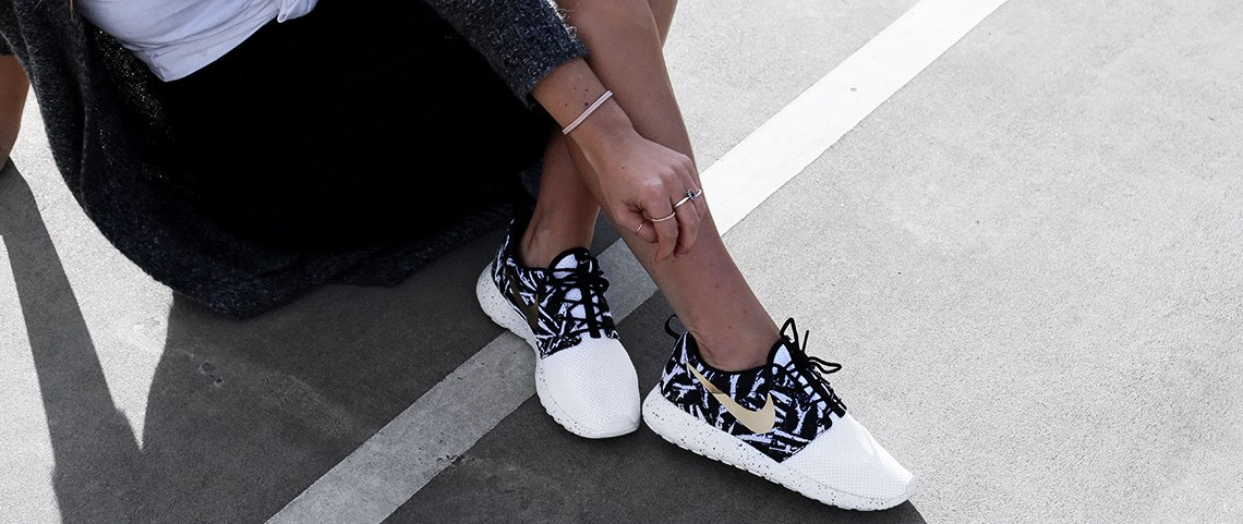 Health blogger Lisa Hamilton from See Want Shop styling her customised gold Nike trainers