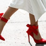 Style blogger Lisa Hamilton from See Want Shop wearing red bow heels at Christmas