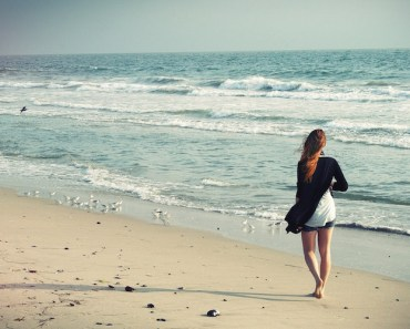 woman-walking-beach-ocean