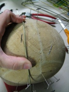 Use the jig to check the bend and length on the wires.