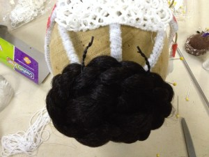 Except....  I know Stephanie has a wig on order, but I don't know where or how it will attach and if it will conflict with my headdress rig, so I did a little defensive construction and attached the double-bun with black twist ties.  I always save those from electronics because they're such a ridiculously great cheat.