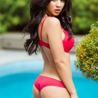 Courtnie Quinlan stuns in red for Page 3