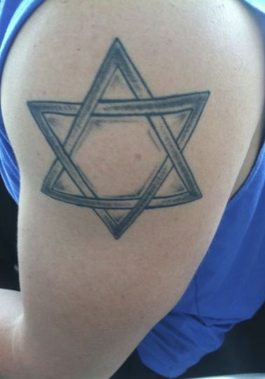 """Our Christian Zionist friend had another tattoo to show us. """"I want to join the IDF,"""" he said, """"but I'm afraid they may not take me because I'm not Jewish."""" We assured our young friend that the IDF would be thrilled to induct him into service."""