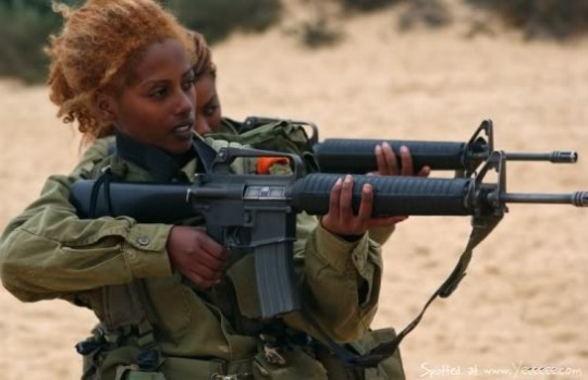 A Jewish Ethiopian woman in the Israeli Defense Forces practices her marksmanship. In Israel, men and women are obligated to serve in the army.