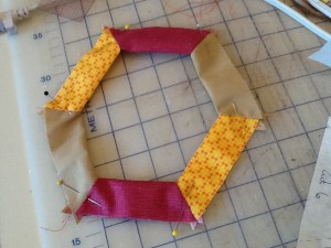 border pieces joined folded and pinned