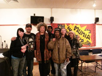 After this Block Report interview at KPFA, the apprentices and other staff who had conducted and assisted with the recording gathered around the legendary Angela Davis for this portrait: from left, Angie D, Frank Sterling, Angela Davis, filmmaker Semaj, Minister of Information JR, Noelle Hanrahan and Mikki Mayes aka Ms. M.  Photo: Adalia