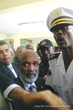 President of Haiti Rene Preval appears worried as his security detachment far outnumbers voters at the polling station where he cast his ballot. - Photo: © 2009 Haiti Information Project, Jean Ristil