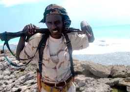 A Somali pirate stands guard on the coast of Hobyo, where his compatriots were holding the Greek tanker MV CPT Stephanos last October. According to early reports, the three Somali pirates killed by the U.S. Navy Sunday were teenagers  16-19 years old.  Photo:  Badri Media/E.P.A./Corbis