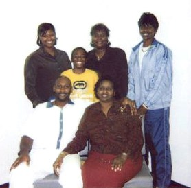 In this 2004 photo taken on death row, Troy Davis is surrounded by his loving family  his mother, Virginia, a nephew and, in back, his sisters, Ebony, Kimberly and Martina.
