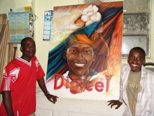 Rosemond Jolissaint, right, shows the painting commemorating his victory at Digicel, Haiti's equivalent of American Idol, with the painter of the portrait. Tens of thousands of Haitians were so moved by his songs that they spent their meager savings on the phone cards required to cast their votes for Rosemond.