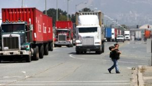 Every day, 10,000 trucks spewing diesel exhaust roll in and out of the port in West Oakland, where 20 percent of the children and 37 percent of the adults have asthma. – Photo: Kim Komenich