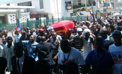 Mourners at the funeral of Haitian priest Father Gerard Jean-Juste march with his coffin in the area of Haiti's national cathedral moments before gunfire erupted. – Photo: ©2009 Jean Ristil, Haiti Information Project