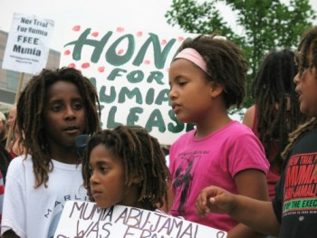 Mumia's allegiance to MOVE is reciprocated by these MOVE children speaking out for his freedom at last year's Liberty Bell rally in Philly on the Fourth of July. – Photo: Joe Piette, Workers World