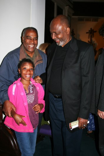 Pierre Labossiere with his daughter Malaika glow in the presence of Father Gerry Jean-Juste when he spoke on Sept. 9, 2006, at St. Joseph the Worker Church in Berkeley. Everyone is invited to return there for his memorial on Saturday, June 27, at 7 p.m. The church is located at 1640 Addison in Berkeley. – Photo: Minister of Information JR