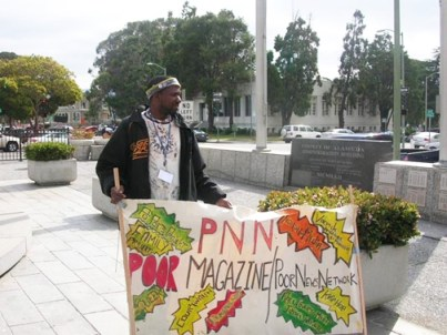 Outside Alameda County Supervisors offices, Ruyata Akio McGlothlin RAM protests budget cuts to General Assistance that will leave almost nothing for the poorest people. – Photo: PNN Staff