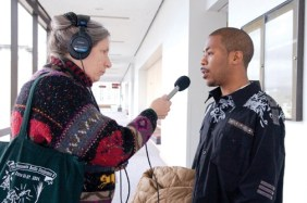 Adrienne Lauby of Free Speech Radio News, heard on KPFA and 93 stations around the country, interviews JR at his court hearing Feb. 23, 2009. – Photo: Scott Braley