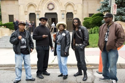 Chairman Fred Hampton Jr. and other key members of the POCC in Chicago prepare to enter the church during the June 9 funeral for then State's Attorney Edward V. Hanrahan, who ordered the assassination of Chairman Fred Hampton and Defense Captain Mark Clarke.
