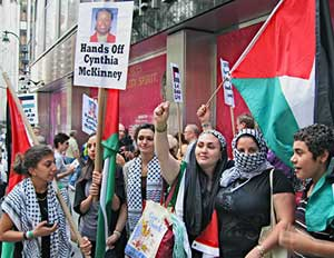 Palestinian women show their love for Cynthia McKinney as they rally in front of the Israeli mission at the U.N. July 1 to free McKinney and the rest of the Free Gaza 21, who had been imprisoned in Israel for trying to break its blockade on Gaza. Days after she was deported back to the U.S., McKinney had joined Viva Palestina, the large caravan led by British Member of Parliament George Galloway.  Photo: Monica Moorehead, Workers World