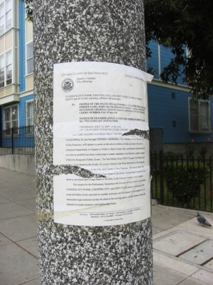 "This official notice, addressed to the ""Knock Out Posse, Chopper City and Eddy Rock criminal street gangs,"" is posted at King Garvey cooperative homes in one of the areas named in the Fillmore gang injunction. – Photo: Chris Brizzard"