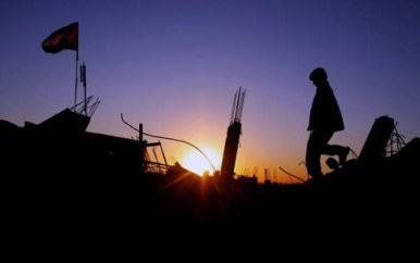 A boy walks on the rubble of a destroyed home in the Gaza Strip.  Photo: Eman Mohammed