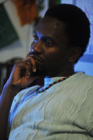 "Kambale Musavuli says in this photo he was ""thinking about how to best break the silence. Revolution? Coalition? or whatever type of -tion?"" To invite him to your campus or community, email Kambale@friendsofthecongo.org."