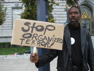 Marlon Crump took part in a recent rally outside San Francisco City Hall against electromagnetic and other covert terrorism to report on it and support the protesters.