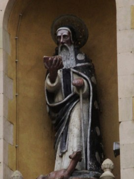 This statue, carved from stone, set high above the town of Agrigento, Italy, in a church tower, depicts the Black African priest, Saint Calogero, the town's patron saint.