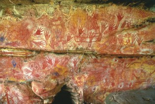 The oldest parts of this Western Australian rock art, painted  in red and yellow ochre  by Black Aboriginal artists 55,000 years ago depict boomerangs, kangaroos, birds, fish and human figures. Sailing ships, rifles and corn pipes were added millennia later when white settlers arrived. Now this stunningly beautiful heritage is threatened by Chevron-Shell liquefied natural gas extraction to feed modern societys  perhaps even San Franciscos  addiction to fossil fuel.