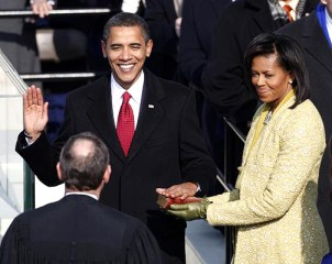 His hand on the Bible from Abraham Lincoln's inauguration, held by his wife, Michelle, Barack Obama takes the oath of office as the 44th president of the United States as he is sworn in by U.S. Supreme Court Chief Justice John Roberts. – Photo: Reuters