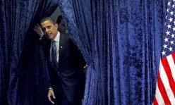 President-elect Barack Obama steps out from behind a curtain. – Photo: Jim Young, Reuters