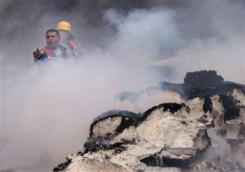 Palestinian firefighters work to try and put out a fire and save bags of food aid at the United Nations headquarters after it was hit in an Israeli bombardment in Gaza City, Thursday, Jan. 15. Hunger is widespread in Gaza. – Photo: Hatem Moussa, AP