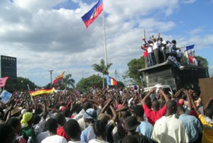 Thousands of Haitians demonstrated throughout Haiti on Dec. 16 to commemorate the date in 1990 of Haiti's first free and democratic elections, the birth of the Lavalas political movement and the election of President Aristide. Now, 18 years later, they are demanding the return of Aristide from exile, an end to the U.N. occupation, the release of all Lavalas political prisoners, and an end to profiteering by Haiti's predatory wealthy elite that results in misery and hunger. – Photo: ©2008 Jean Ristil, HIP