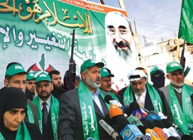"In this photo taken Feb. 13, 2006, shortly after Hamas won a fair, democratic election, Palestinian Prime Minister Ismail Haniyeh is rekindling hopes for peace by calling for a ""giant summit with all living Israelis."" He is described in this story as ""a man who has helped to save the lives of more Jews than anyone in the Knesset"" by supporting the ban on suicide missions. – Photo: The Onion"