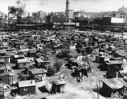 Foreclosures and evictions were rampant in the Great Depression, as they are now, and people survived by coming together, claiming urban land and building shantytowns called Hoovervilles like this one in Seattle.