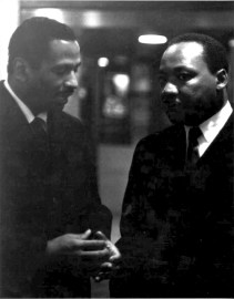 Congressman John Conyers confers with Dr. Martin Luther King Jr. in 1968.